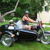 William Clough Jr. of Bradford, N.H., takes his granddaughter on her first ride.
