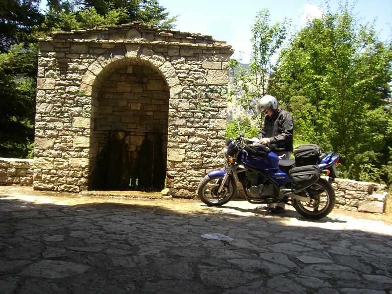 Peter Calles of Bethesda, Md., at a very old well up in the mountains in Greece while visiting the home town of his parents.