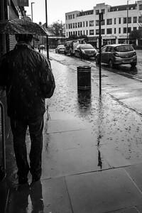 Queueing in the rain