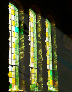 Light Through The Catherdral's Stained Glass Windows