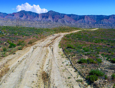 Dirt Road To Mountain Range