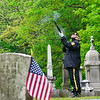 KRISTOPHER RADDER — BRATTLEBORO REFORMER<br /> Susan McAllister, a member of the American Legion Post 5 Color Guard, in Brattleboro, Vt., participates in a modified firing squad during a Memorial Day service at Prospect Cemetery, in Brattleboro, on Monday, May 25, 2020. The services were kept small because of the COVID-19 pandemic.