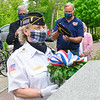 KRISTOPHER RADDER — BRATTLEBORO REFORMER<br /> Carol Macie, president of the American Legion Auxiliary Unit 5 and the VFW Auxiliary 1034, in Brattleboro, Vt., lays a wreath at the Kyle Gilbert Memorial Bridge, in Brattleboro during a Memorial Day service on Monday, May 25, 2020. Kyle Gilbert died Aug. 6, 2003, during an attack in the Al Mansour district in Baghdad, Iraq.