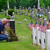 KRISTOPHER RADDER — BRATTLEBORO REFORMER<br /> Robert Gilbert kneels at his son's grave, Locust Ridge Cemetery, in Brattleboro, Vt., on Memorial Day on Monday, May 25, 2020. Kyle Gilbert died Aug. 6, 2003, during an attack in the Al Mansour district in Baghdad, Iraq.