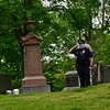 KRISTOPHER RADDER — BRATTLEBORO REFORMER<br /> Brattleboro, Vt., police officer Ryan Washburn salutes during a Memorial Day service at Prospect Cemetery, in Brattleboro, on Monday, May 25, 2020. The services were kept small because of the COVID-19 pandemic.