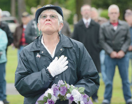 Cleo Splane of the American Legion, George Baldridge Post 43 Women's Auxiliary, salutes as she prepares to hang a commemorative wreath at Union Cemetery in Sedro Woolley. Memorial Day services were held Monday throughout Skagit County. Scott Terrell / Skagit Valley Herald