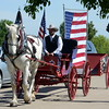 Troy Hall of Colorado Carriage & Wagon in Fort Collins drives Jill, a Percheron draft horse, and the company's patriotic buggy at the Memorial Day event sponsored by Resthaven Memory Gardens north of Loveland on Monday, May 30, 2016. (Photo by Craig Young / Loveland Reporter-Herald)