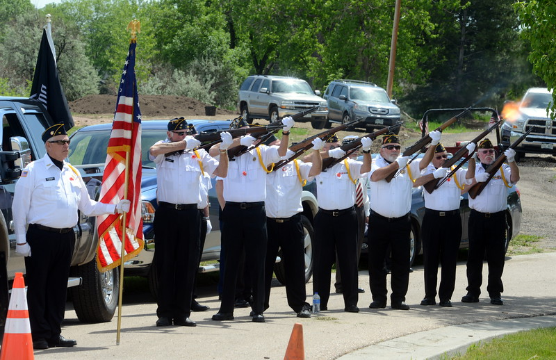 Members of the Associated Veterans of Loveland fire a rifle volley before the playing of taps during Memorial Day events Monday, May 30, 2016, at Resthaven Memory Gardens north of Loveland. (Photo by Craig Young / Loveland Reporter-Herald)