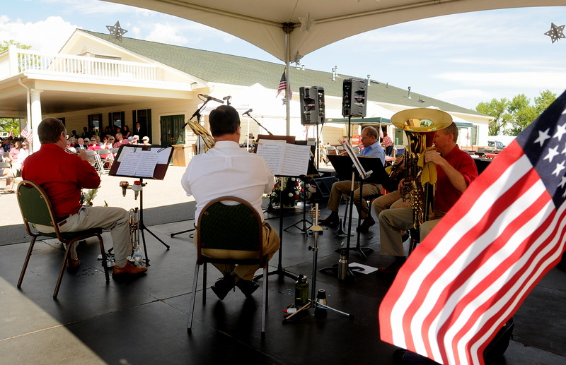 Fort Collins resident Mark Manges, right, Jim Schafer of Loveland, left, and other members of the Big Thompson Brass Quintet play for the Memorial Day event at Resthaven Memory Gardens north of Loveland on Monday, May 30, 2016. (Photo by Craig Young / Loveland Reporter-Herald)
