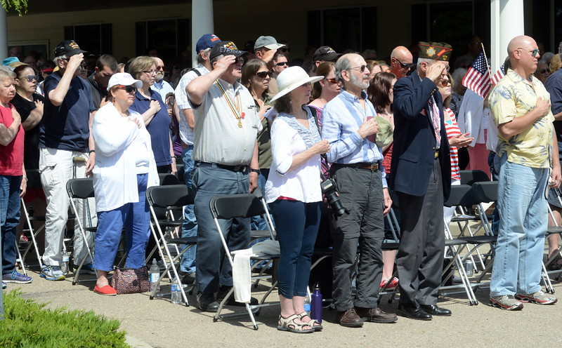 Audience members stand as the honor choir from Greeley's Frontier Academy sings the national anthem during the Memorial Day ceremony at Resthaven Memory Gardens north of Loveland on Monday, May 30, 2016. (Photo by Craig Young / Loveland Reporter-Herald)