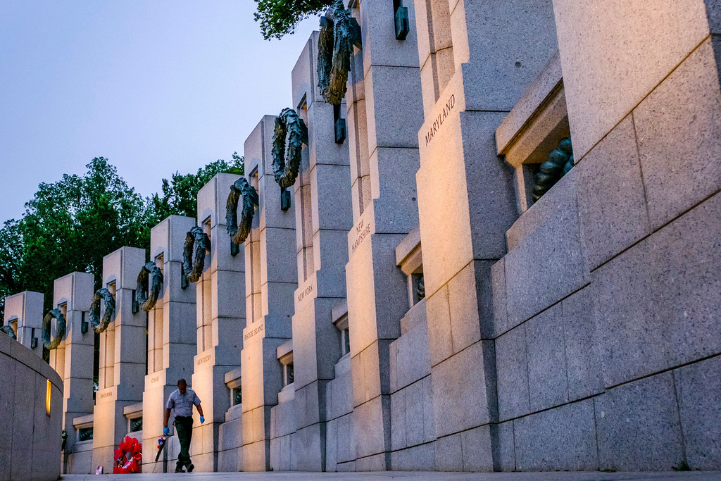 . A member of the National Park Service inspects the walkway at the World War II Memorial early in the morning before the Memorial Day events in Washington, Monday, May 29, 2017. (AP Photo/J. David Ake)