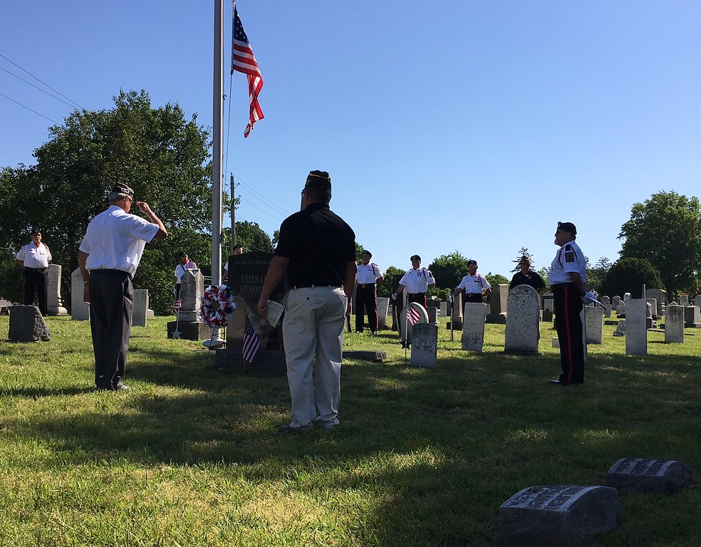 . Richard Payerchin - The Morning Journal <br> Amherst veterans perform the ceremony to honor the community\'s fallen fighters in the community salute at the Amherst Veterans Memorial in the Cleveland Street Cemetery before the Amherst Memorial Day Parade on May 29, 2017. Hundreds of people came out to communities across Lorain County for Memorial Day services.