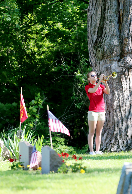 . Jonathan Tressler - The News-Herald Abby Wren, a soon-to-be-senior at Perry High School, plays Echo Taps at Lane Road Cemetery in Perry Township May 29 during the community\'s Memorial Day observances.