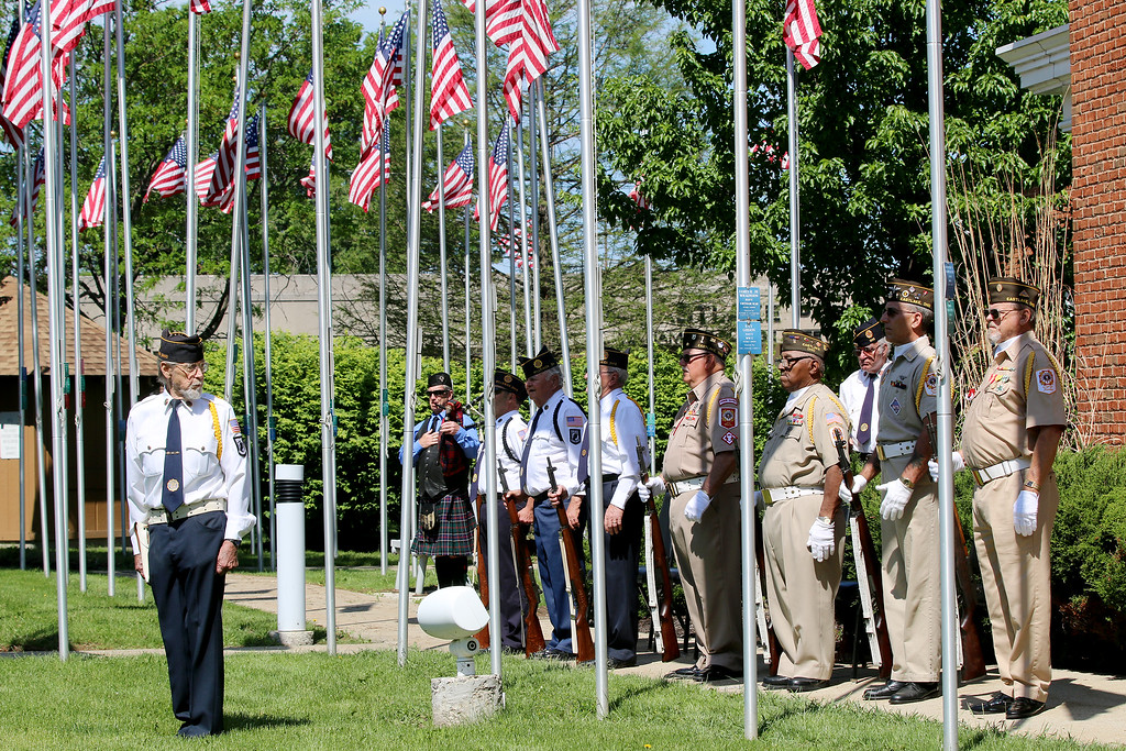 """. Jonathan Tressler - The News-Herald Eastlake American Legion Post 678 honor guard commander Harold \""""Hal\"""" Hildebrecht checks his crew May 29 during the Memorial Day Service at Eastlake City Hall before the customary 21-gun salute to fallen soldiers."""