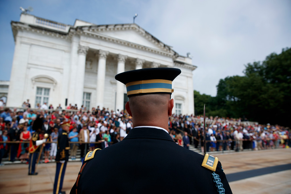 . A member of a military honor guard stands post during a wreath laying ceremony with President Donald Trump at Arlington National Cemetery, Monday, May 29, 2017, in Arlington, Va. (AP Photo/Evan Vucci)