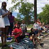 Richard Payerchin - The Morning Journal <br> Enfiniti Goodwin, 14, left, stands on West Erie Avenue to watch those marching in the Lorain Memorial Day Parade on May 29, 2017. She was with Elijah Johnson, 8, center, and Jamier Hall, 9, right, among other friends and family members for the parade.