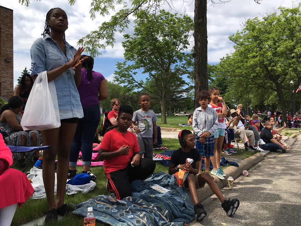 . Richard Payerchin - The Morning Journal <br> Enfiniti Goodwin, 14, left, stands on West Erie Avenue to watch those marching in the Lorain Memorial Day Parade on May 29, 2017. She was with Elijah Johnson, 8, center, and Jamier Hall, 9, right, among other friends and family members for the parade.