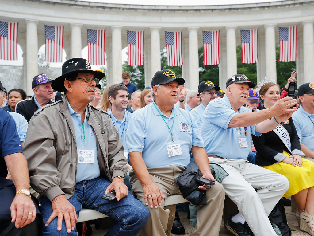 . From left, Cruzer Cruz, Manny Soto, Ron Anderson, and other members of \'Honor Flight Austin\' take their seats at the Memorial Amphitheater in Arlington National Cemetery in Arlington, Va., Monday, May 29, 2017, before the start of a Memorial Day ceremony. Honor Flight Austin serves veterans from the Austin, Texas area by sending them to the nation\'s capital to attend Memorial Day Observance. (AP Photo/Pablo Martinez Monsivais)