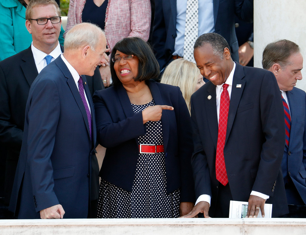. Homeland Security Secretary John Kelly, left, talks with Housing and Urban Development Secretary Ben Carson, right, and Carson\'s wife Candy Carson, center, as they arrive at the Memorial Amphitheater in Arlington National Cemetery in Arlington, Va., Monday, May 29, 2017, to attend a Memorial Day ceremony. Also taking his seat is Veterans Affairs Secretary David Shulkin, far right. (AP Photo/Pablo Martinez Monsivais)