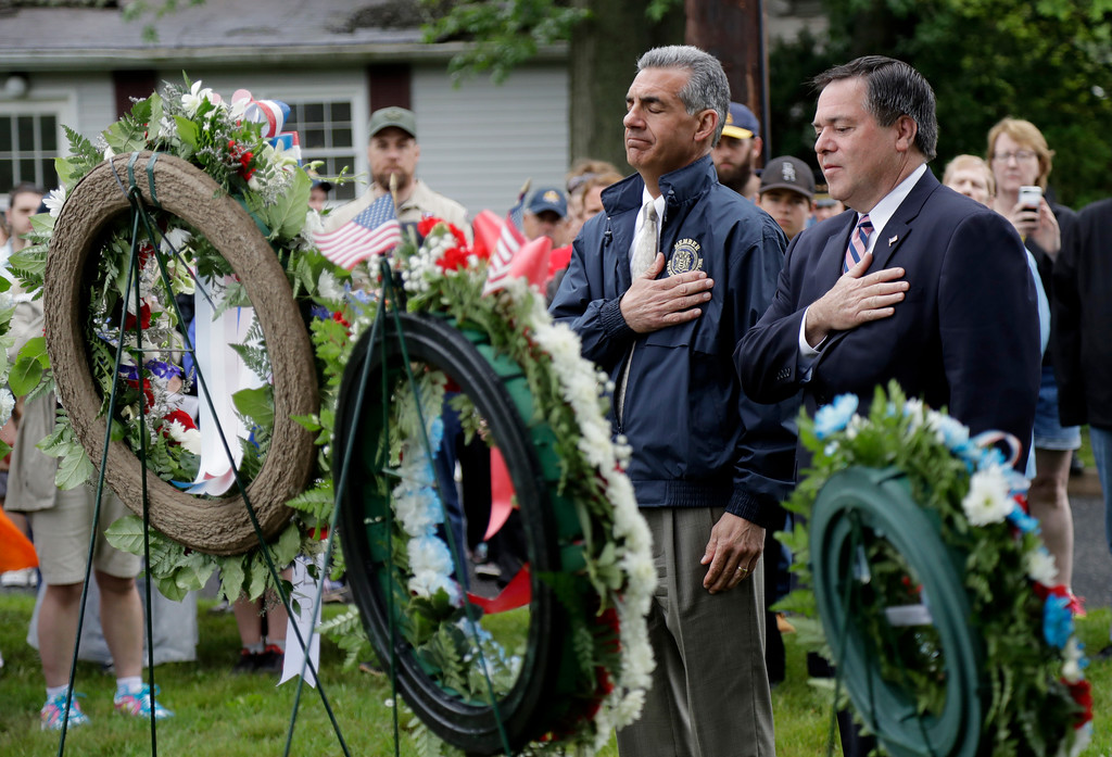 . New Jersey Assemblyman Jack Ciattarelli, left, who is a Republican candidate in next week\'s gubernatorial primary election, and Daniel Hayes Jr., mayor of Bridgewater, N.J., salute during a Memorial Day observance, Monday, May 29, 2017, in Bridgewater, N.J. (AP Photo/Julio Cortez)