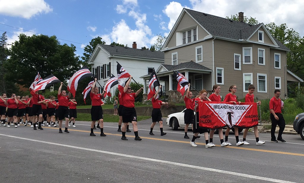 . Richard Payerchin - The Morning Journal <br> Members of the Firelands High School Marching Band perform in the Florence Township/Birmingham Memorial Day Parade on May 29, 2017. Hundreds of people across northern Ohio came out to honor Amerca\'s fallen defenders in community Memorial Day services.