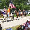 Richard Payerchin - The Morning Journal <br> Riders from Clearview Stables of Berlin Heights carry flags as they and their horses march participate in the Florence Township/Birmingham Memorial Day Parade on May 29, 2017. The riders were among dozens of participants in the parade around Birmingham, the village near the crossroads of SR 60 and SR 113 in Florence Township, Erie County.
