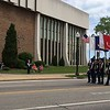 Richard Payerchin - The Morning Journal <br> The color guard marches past the Lorain Police Department with flags of the armed forces during the Lorain Memorial Day Parade on May 29, 2017.