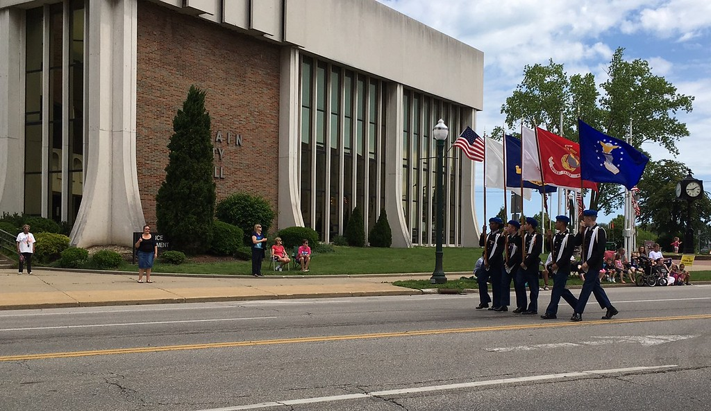 . Richard Payerchin - The Morning Journal <br> The color guard marches past the Lorain Police Department with flags of the armed forces during the Lorain Memorial Day Parade on May 29, 2017.