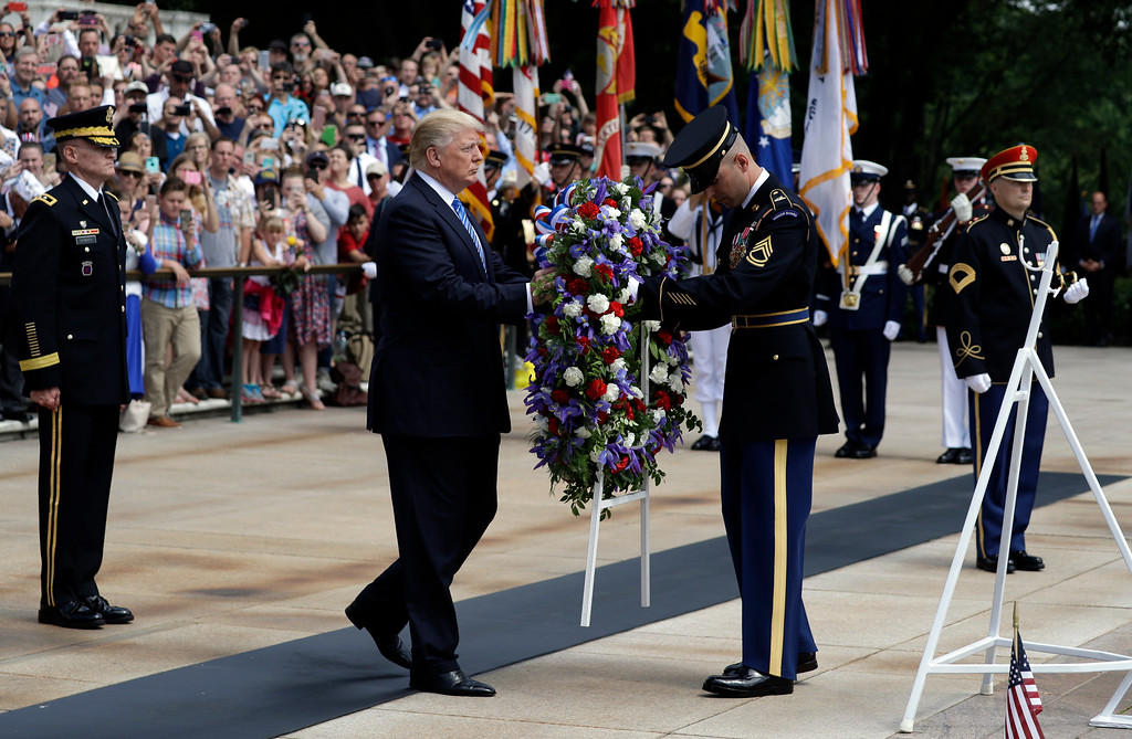 . President Donald Trump lays a wreath at The Tomb of the Unknown Solider at Arlington National Cemetery, Monday, May 29, 2017, in Arlington, Va. (AP Photo/Evan Vucci)