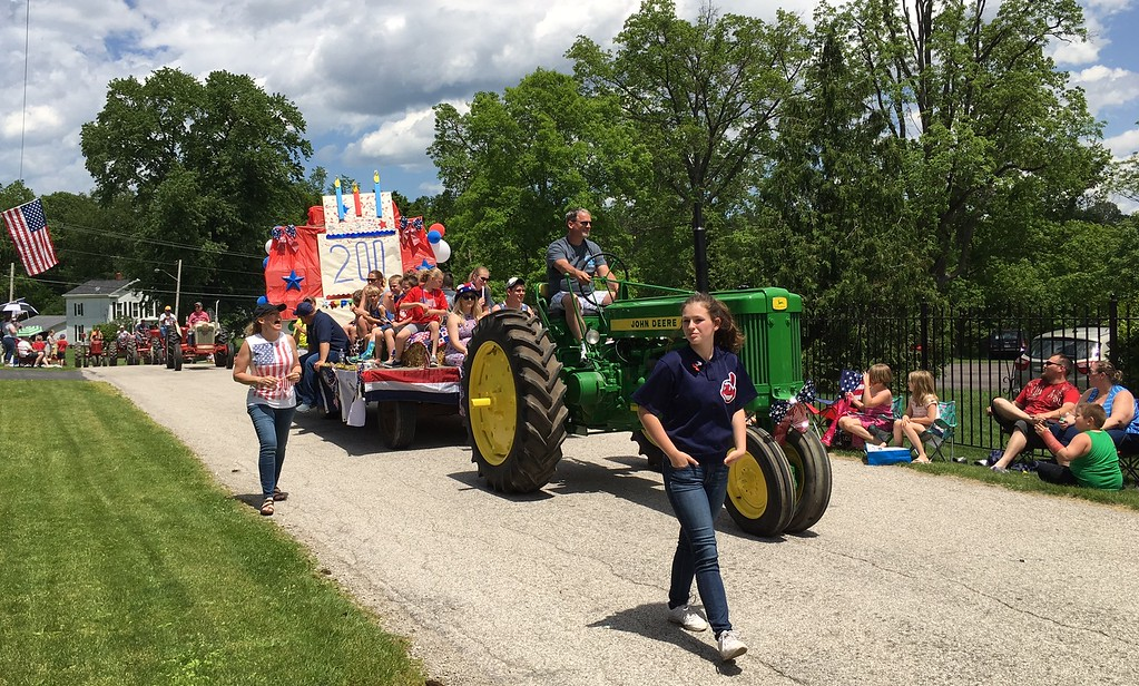 . Richard Payerchin - The Morning Journal <br> A tractor pulls a float themed with Happy 200th Birthday to honor the bicentennial of Florence Township in Erie County during the Florence Township/Birmingham Memorial Day Parade on May 29, 2017.