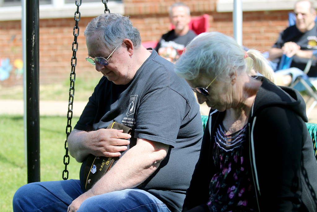 . Jonathan Tressler - The News-Herald Don Meivogal, left, and wife Suzi Hoffman pay their respects during a somber part of the Memorial Day service behind Eastlake City Hall May 29.
