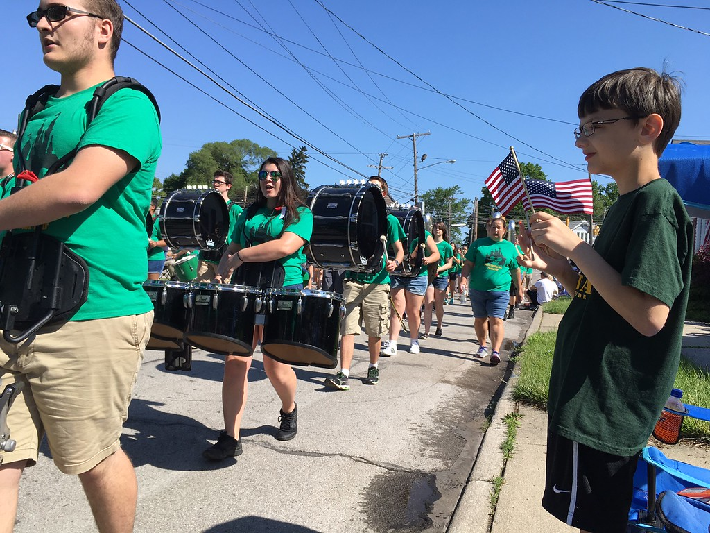 . Richard Payerchin - The Morning Journal <br> Chad Miller, 9, of Amherst, holds his flags as the Amherst Comets Marching Band pass by in the Amherst Memorial Day Parade on May 29, 2017. Hundreds of people came out to communities across Lorain County for Memorial Day services.