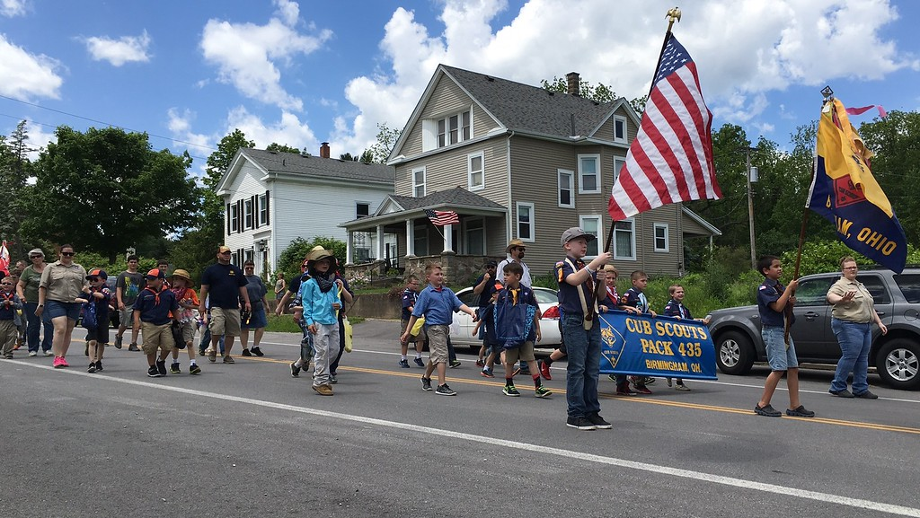 . Richard Payerchin - The Morning Journal <br> Members of Cub Scouts Pack 435 of Birmingham march during the Florence Township/Birmingham Memorial Day Parade on May 29, 2017.