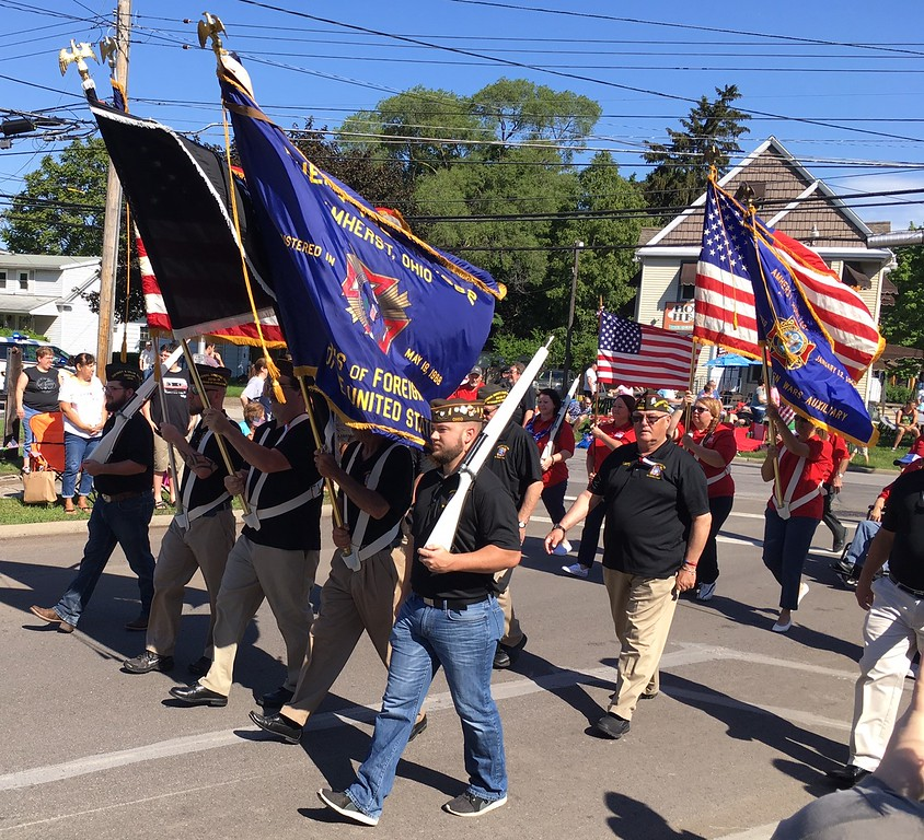 . Richard Payerchin - The Morning Journal <br> Members of Amherst veterans groups march to start the Amherst Memorial Day Parade on May 20, 2017. Hundreds of people came out to communities across Lorain County for Memorial Day services.