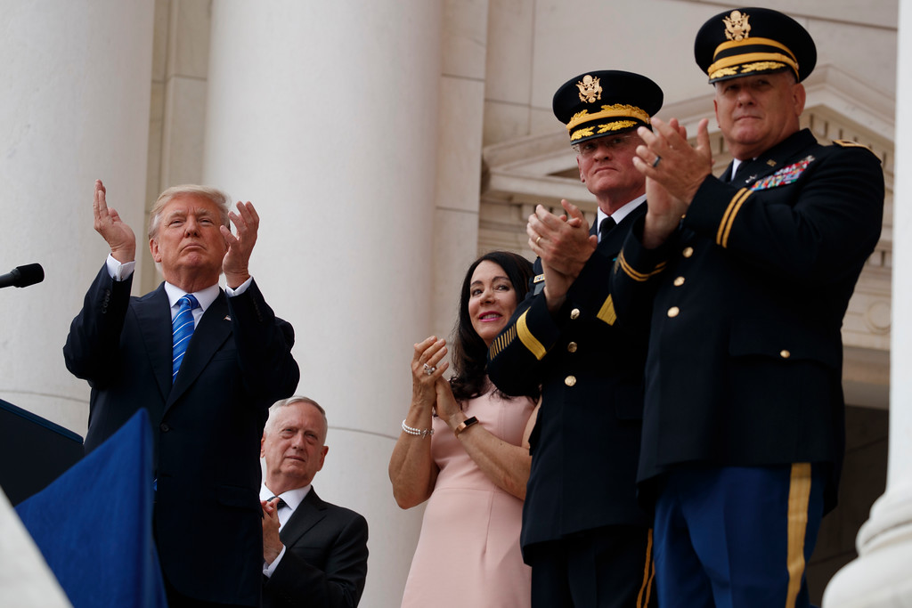 . President Donald Trump applauds as he pauses during his speech at a Memorial Day ceremony at Arlington National Cemetery, Monday, May 29, 2017, in Arlington, Va. (AP Photo/Evan Vucci)