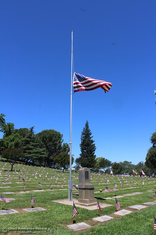 . Steve Schoonover -- Mercury-Register A flag flies at half-staff amongst a sea of veterans graves, all marked with flags, during Memorial Day services at Memorial Park Cemetery in Oroville, Monday May 28, 2018.