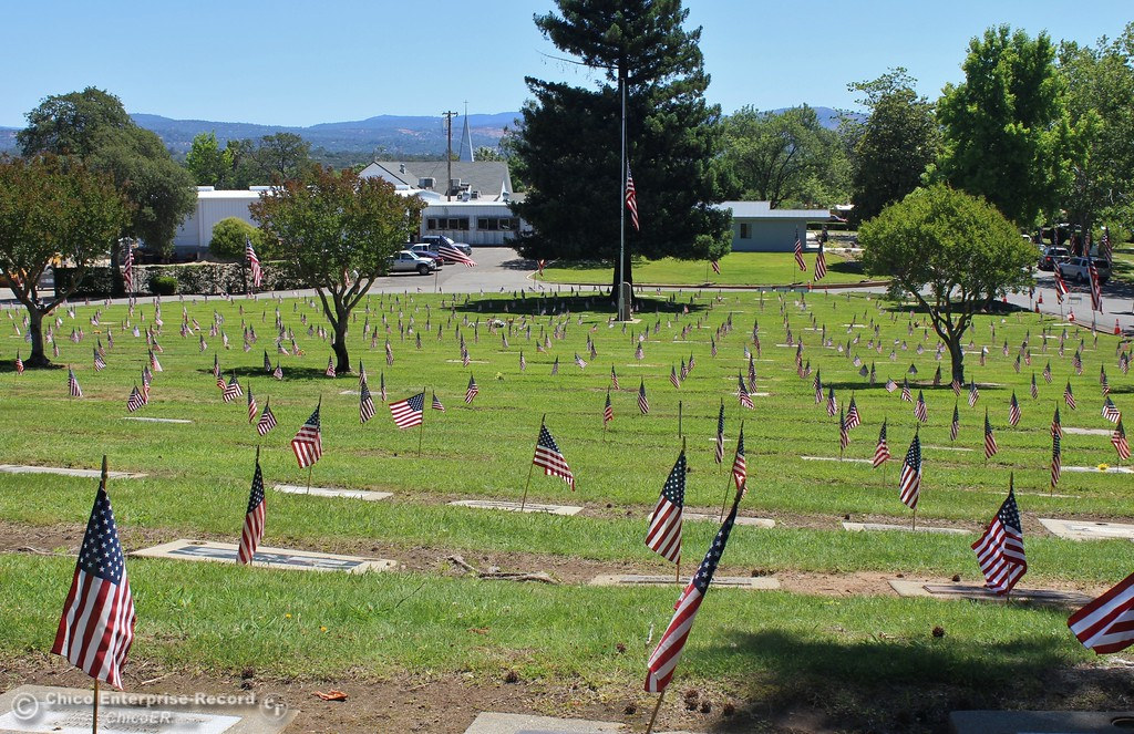 . Steve Schoonover -- Mercury-Register A hillside covered with veterans graves, all marked with American flags, during Memorial Day services at Memorial Park Cemetery in Oroville, Monday May 28, 2018.