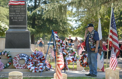 US Submarine Veteran Gil Houston salutes after he places a wreath during the Memorial Day Ceremony held at the Chico Cemetery in Chico, Calif. Monday, May 28, 2018. (Bill Husa -- Enterprise-Record)