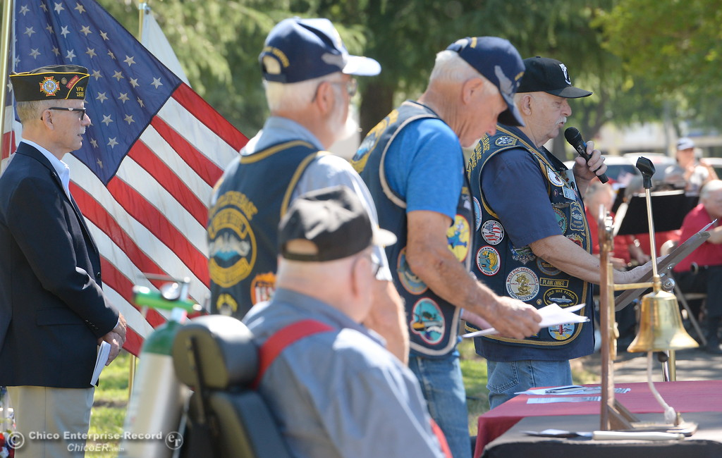 . US Submarine Veteran Gil Houston reads a list of soldiers lost during the tolling of the Bells during the Memorial Day Ceremony held at the Chico Cemetery in Chico, Calif. Monday, May 28, 2018. (Bill Husa -- Enterprise-Record)
