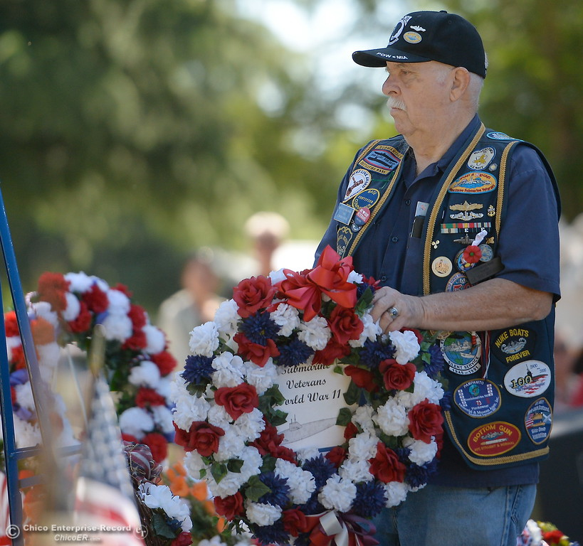 . US Submarine Veteran Gil Houston places a wreath during the Memorial Day Ceremony held at the Chico Cemetery in Chico, Calif. Monday, May 28, 2018. (Bill Husa -- Enterprise-Record)