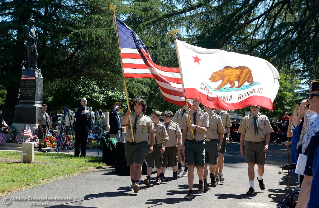 . The Boy Scouts of America Color Guard retire the colors near the end of the Memorial Day Ceremony held at the Chico Cemetery in Chico, Calif. Monday, May 28, 2018. (Bill Husa -- Enterprise-Record)