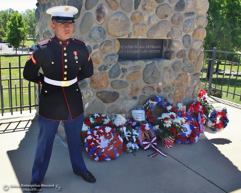 . Steve Schoonover -- Mercury-Register A Marine stands guard over wreaths laid at the veterans monument during Memorial Day services at Memorial Park Cemetery in Oroville, Monday May 28, 2018.