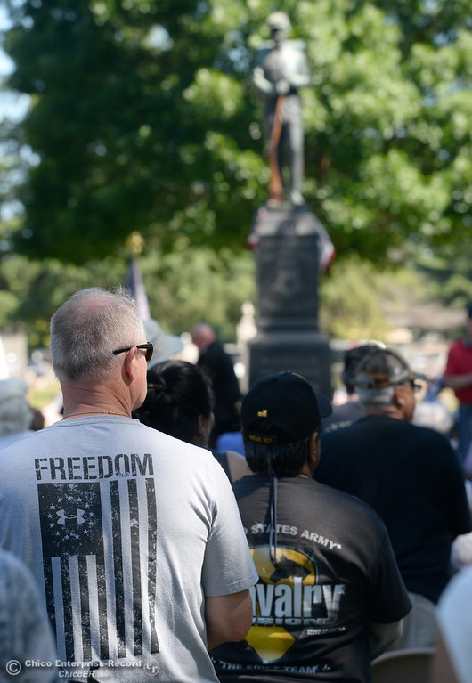 ". Veteran Rick Schortgen of Chico stands with a ""Freedom\"" shirt during the Memorial Day Ceremony held at the Chico Cemetery in Chico, Calif. Monday, May 28, 2018. (Bill Husa -- Enterprise-Record)"