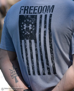 "Veteran Rick Schortgen of Chico stands with a ""Freedom"" shirt during the Memorial Day Ceremony held at the Chico Cemetery in Chico, Calif. Monday, May 28, 2018. (Bill Husa -- Enterprise-Record)"