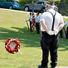 Effingham AMVETS Post 40 Commander Robert L. McWhorter stands at parade rest during the placing of the wreaths at the Memorial Day Ceremonies held Monday morning at Oakridge Cemetery in Effingham. Charles Mills photo