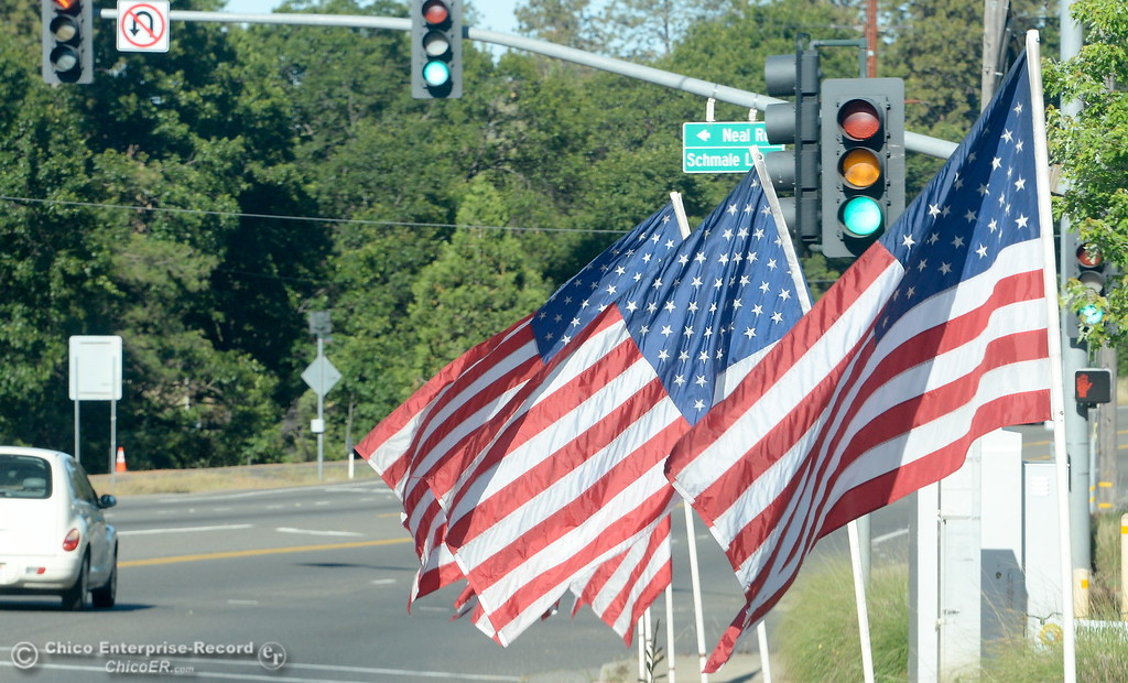 . Flags fly along the Skyway in Paradise in honor of Memorial Day in Paradise, Calif. Monday, May 28, 2018. (Bill Husa -- Enterprise-Record)