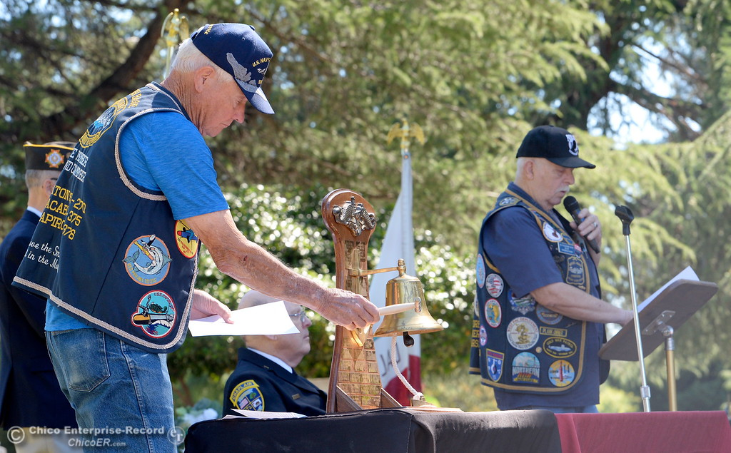 . US Submarine Veteran Gary Newquist tolls the Bell at left while US Submarine Veteran Gil Houston reads a list of soldiers lost during the tolling of the Bells segment of the Memorial Day Ceremony held at the Chico Cemetery in Chico, Calif. Monday, May 28, 2018. (Bill Husa -- Enterprise-Record)