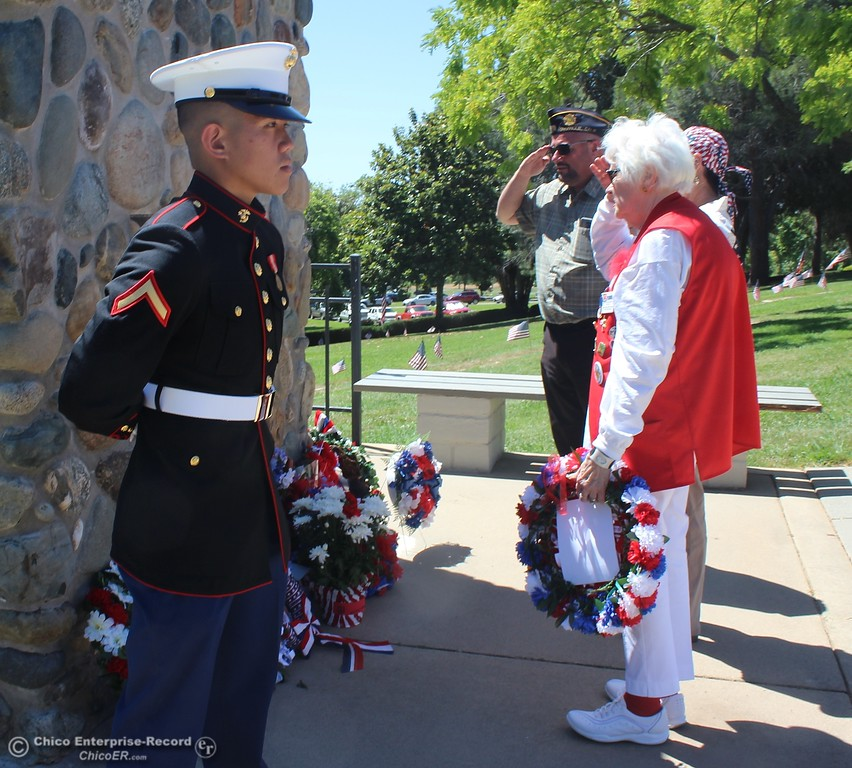 . Steve Schoonover -- Mercury-Register A salute is offered with the placing on a wreath at the veterans monument during Memorial Day services at Memorial Park Cemetery in Oroville, Monday May 28, 2018.