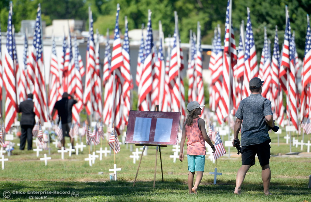 . People stroll through the Veterans section during the Memorial Day Ceremony held at the Chico Cemetery in Chico, Calif. Monday, May 28, 2018. (Bill Husa -- Enterprise-Record)
