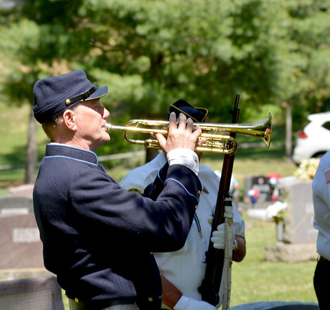 Matt Stead plays taps during the Memorial Day Ceremonies held Monday morning at Oakridge Cemetery in Effingham. Effingham American Legion Post 120 and Auxiliary hosted this year's services. Charles Mills photo